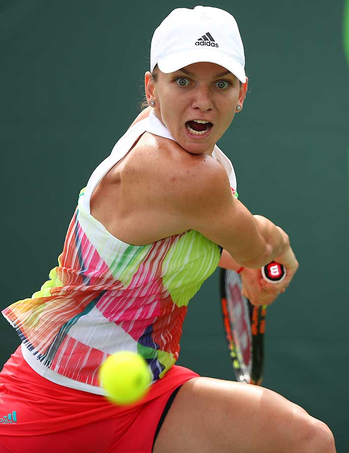 Simona Halep of Romania plays a forehand in the fourth round of the Miami Open in Key Biscayne, Fla.