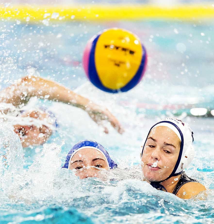 The U.S. women's water polo team won the gold medal in the Olympic qualifying tournament Monday, outscoring its eight opponents in the competition 123-34. Pictured here, Aria Fischer (right) fights for the ball against Roberta Bianconi of Italy.