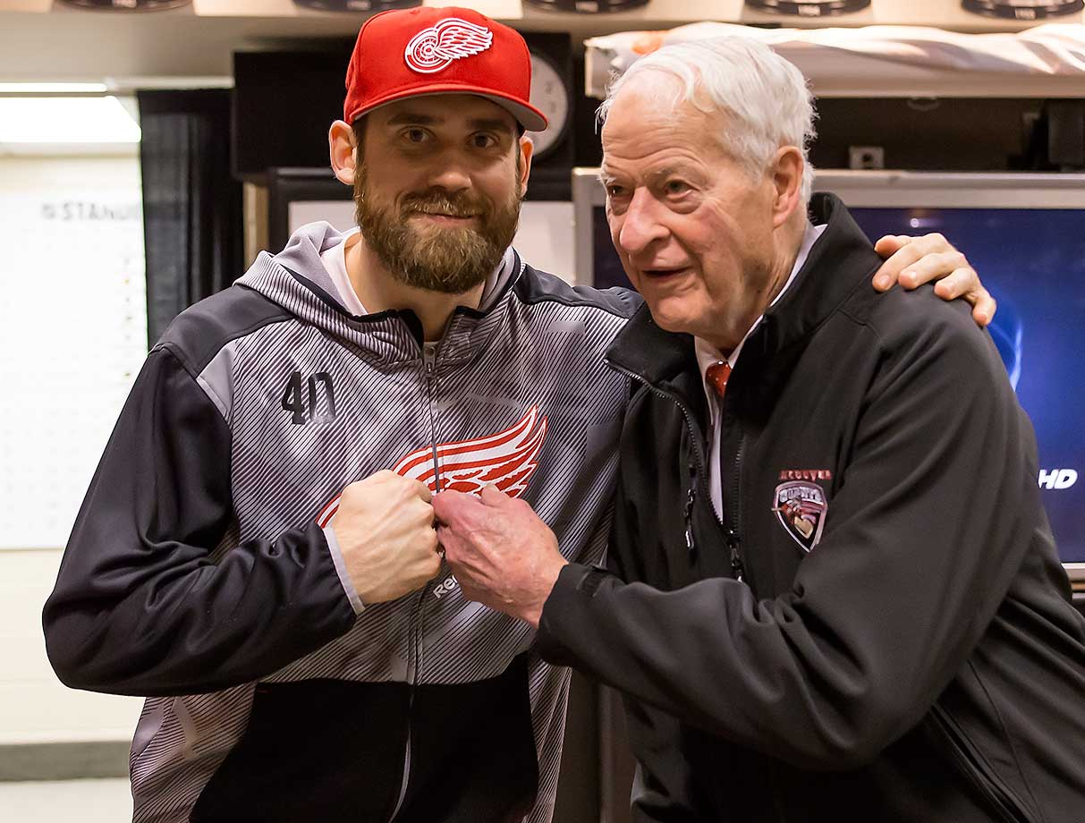 Detroit Red Wings legend and Hall of Famer Gordie Howe pounds knuckles with Henrik Zetterberg of the Red Wings before a game against Buffalo. The team surprised Howe by celebrating his 88th birthday three days early.