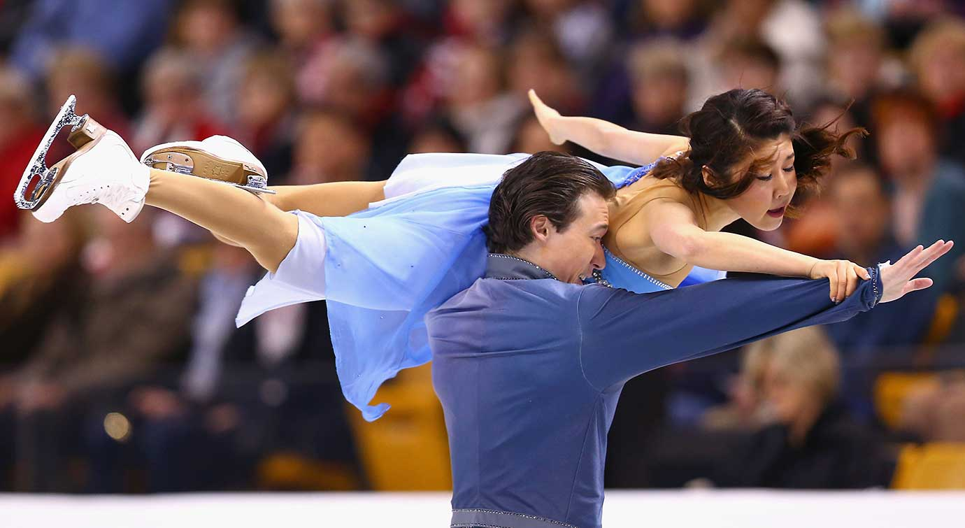 Kana Muramoto and Chris Reed of Japan compete during the World Figure Skating Championships.
