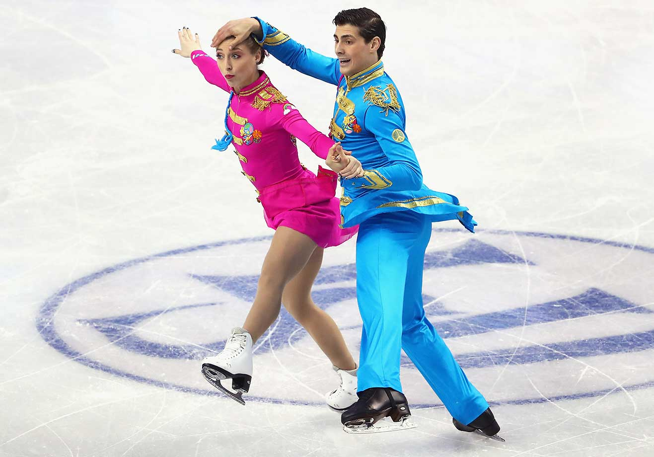 Piper Gilles and Paul Poirier of Canada skate in the short program during day 3 of the ISU World Figure Skating Championships in Boston.