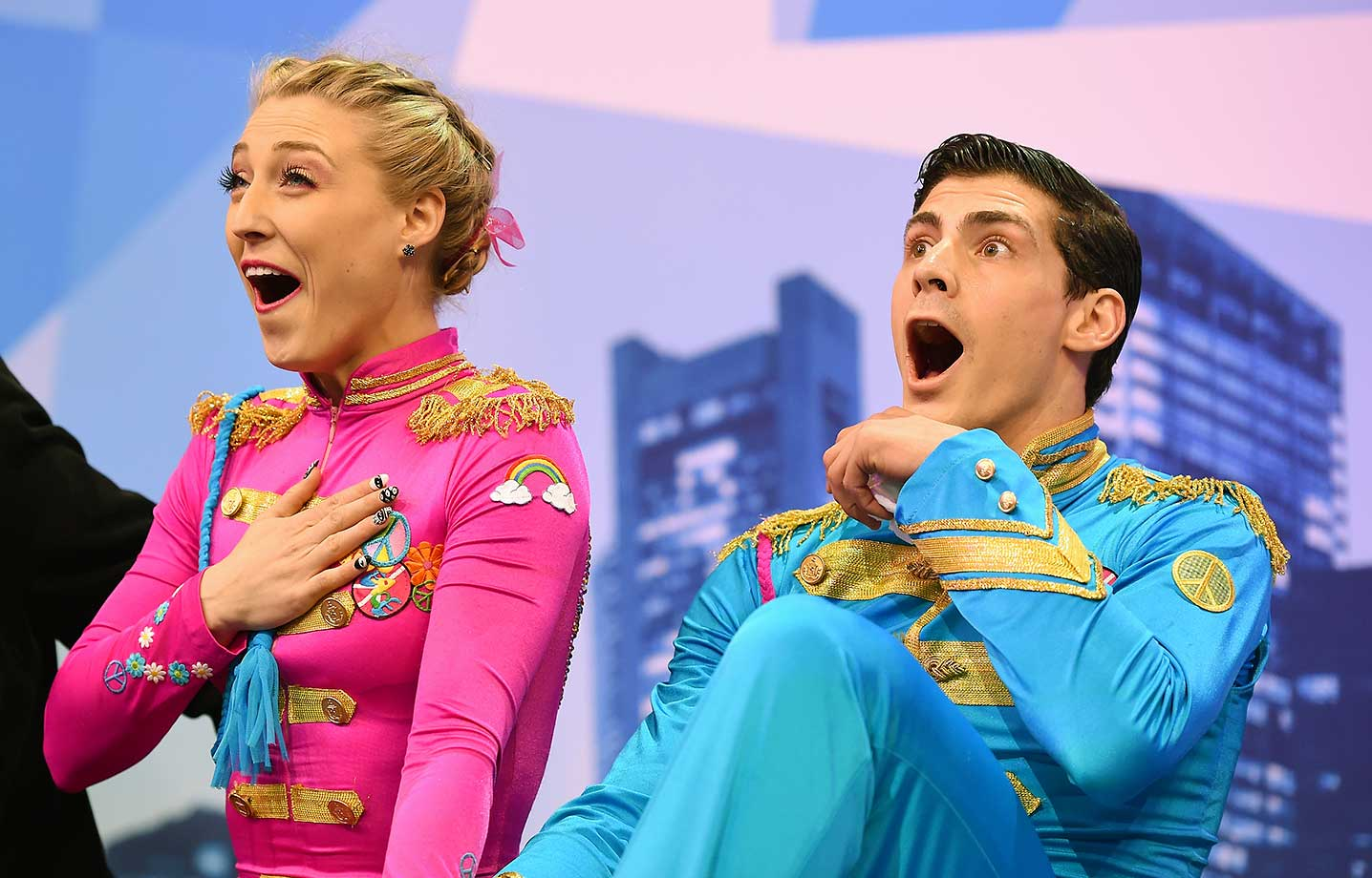Piper Gilles and Paul Poirier of Canada react after seeing their scores at the World Figure Skating Championships. (More skating at the back of this gallery.)