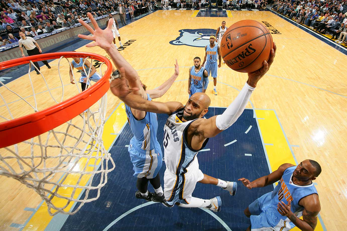 Vince Carter of the Memphis Grizzlies shoots the ball against the Denver Nuggets.