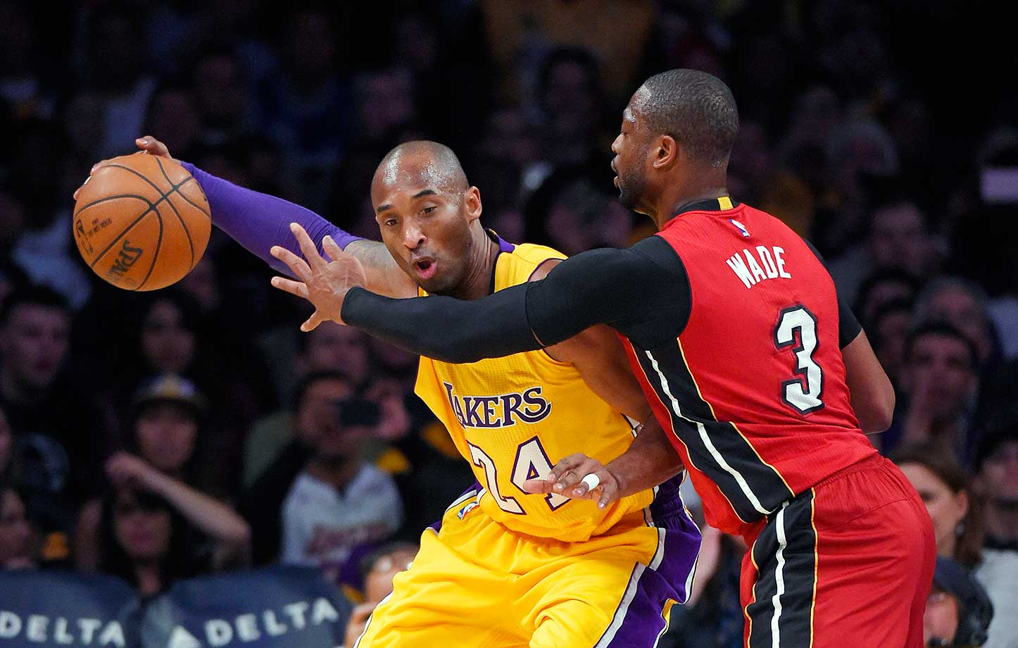 Miami Heat guard Dwyane Wade puts pressure on Lakers forward Kobe Bryant.