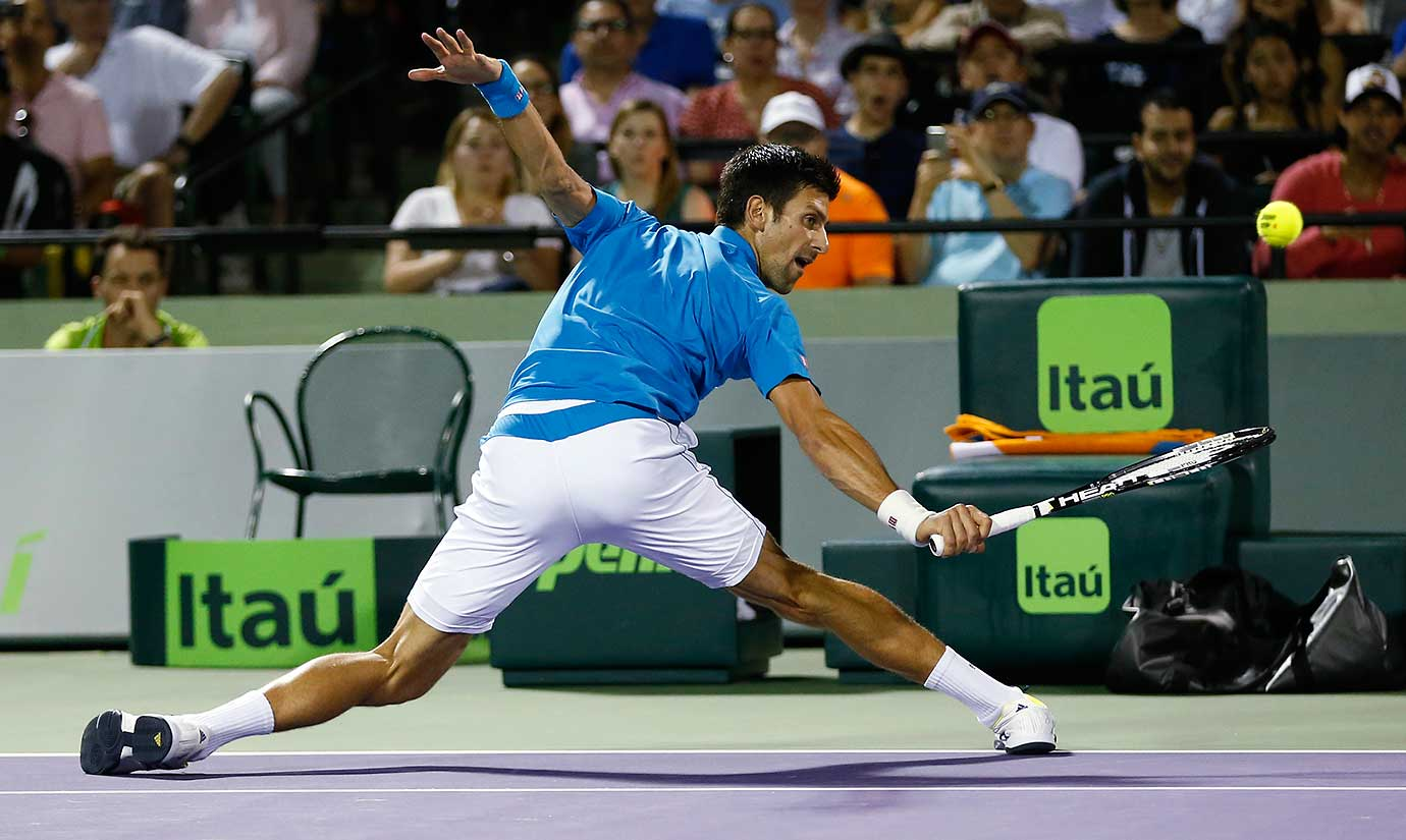 Novak Djokovic stretches to return the ball to Tomas Berdych at the Miami Open. Djokovic won 6-3, 6-3.