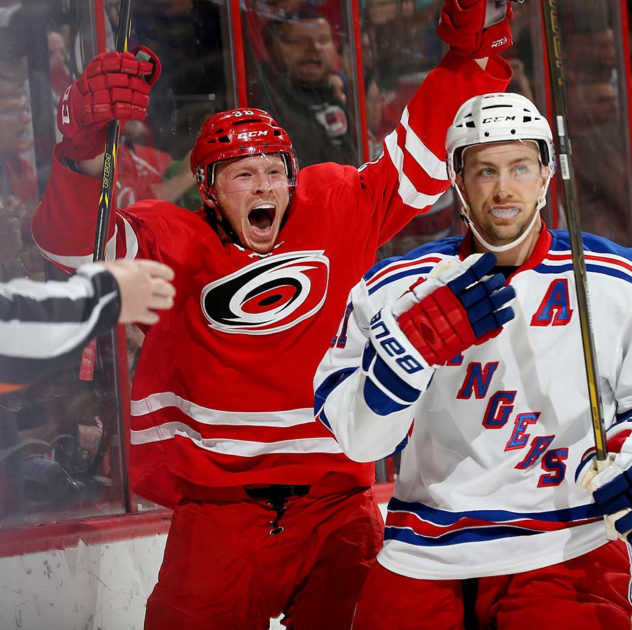 Patrick Brown of the Carolina Hurricanes celebrates after scoring his first NHL goal—against the New York Rangers
