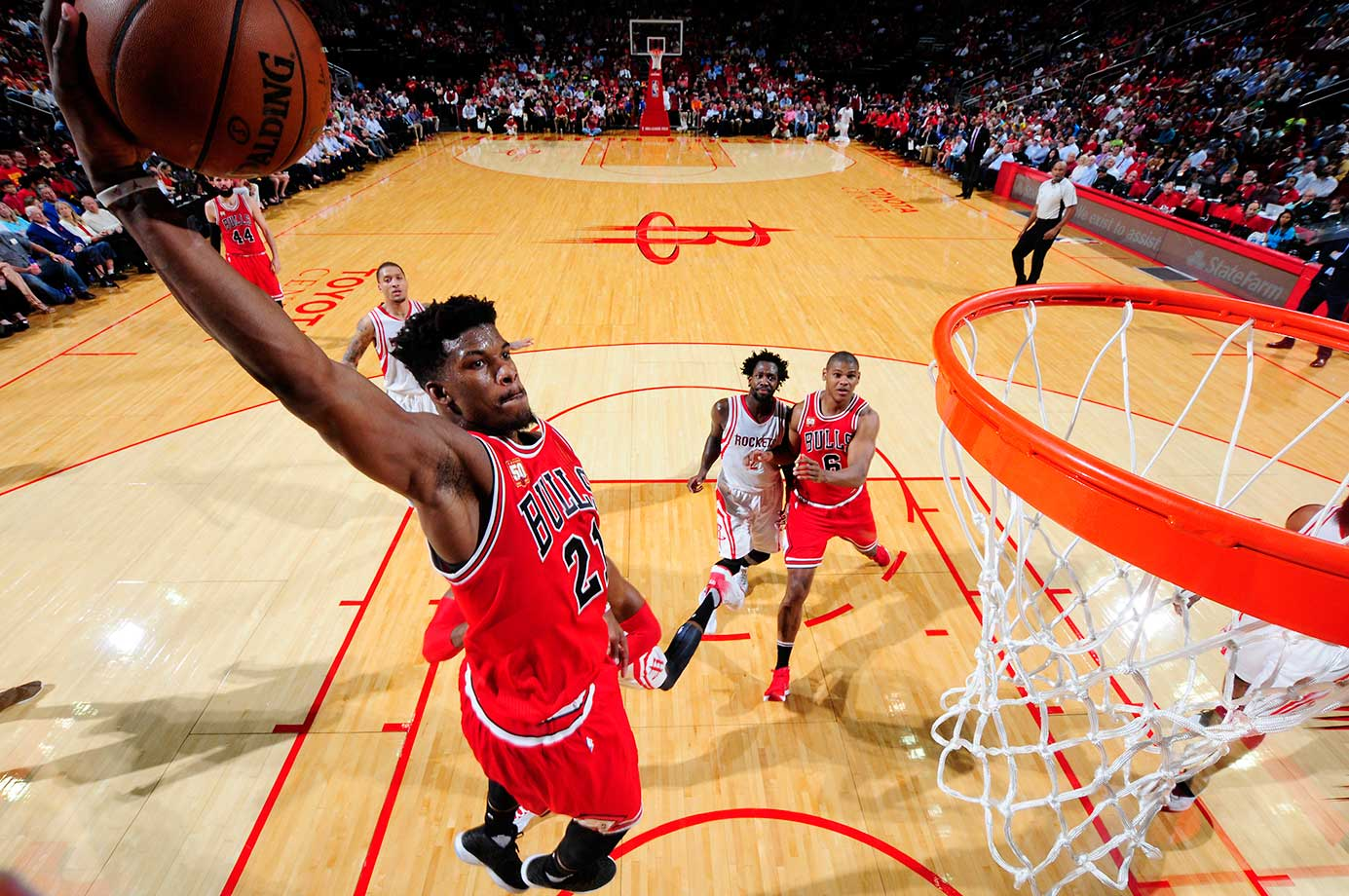 Jimmy Butler of the Chicago Bulls throws down from on high against the Houston Rockets.