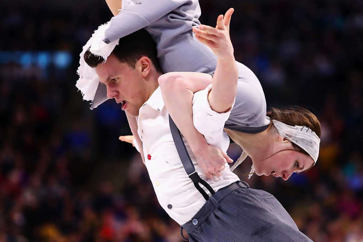 Charlene Guignard and Marco Fabbri of Italy in an unusual position at the World Figure Skating Championships.