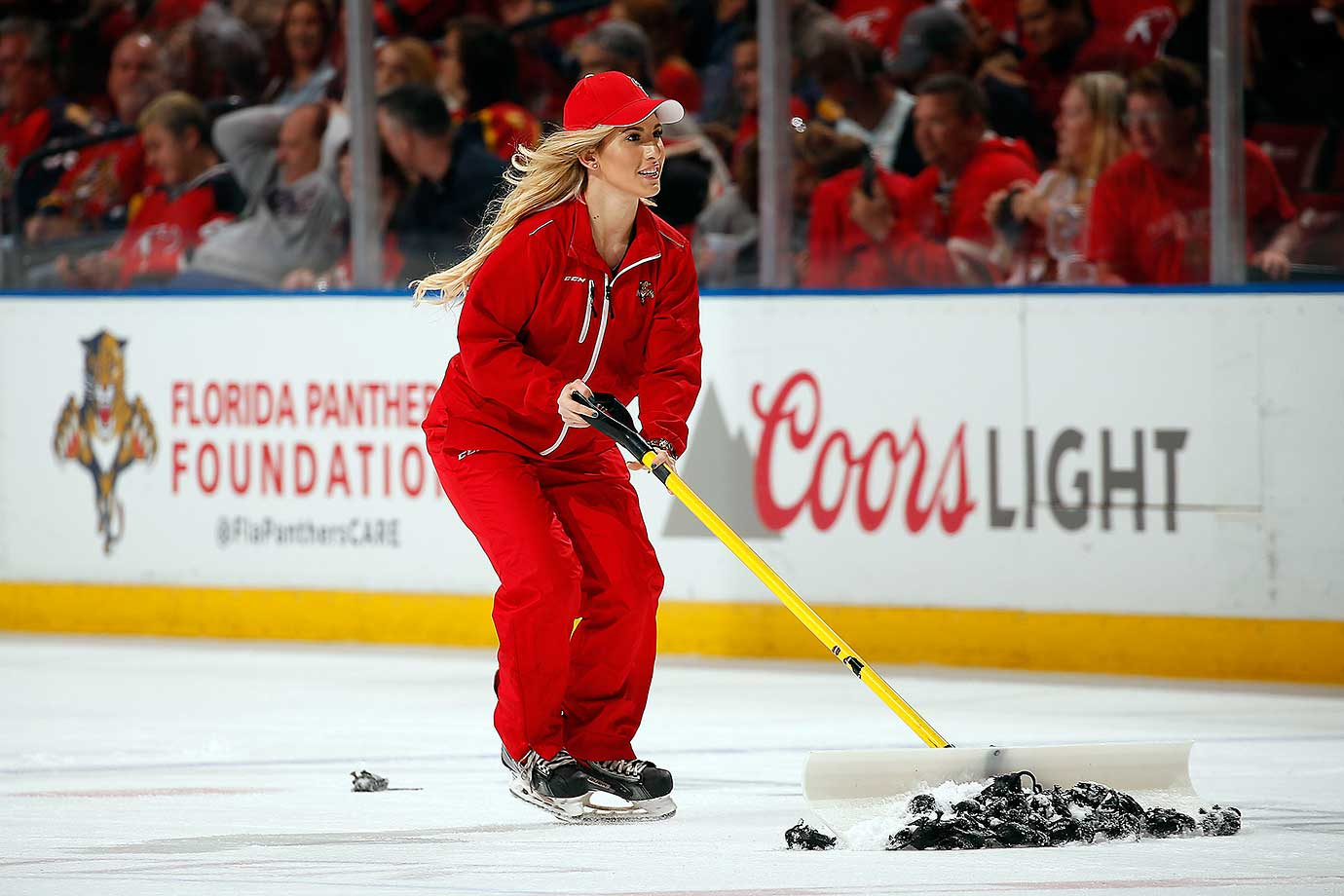 A Florida Panthers Ice Technician gathers up rats that were thrown after the team scored a goal against the New Jersey Devils.