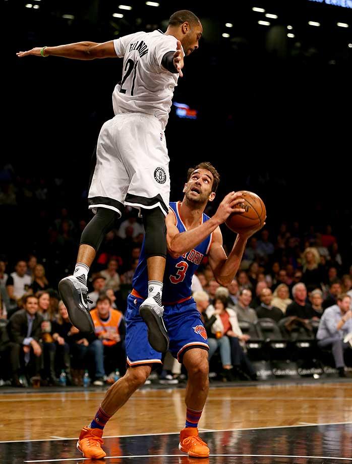 Jose Calderon of the New York Knicks heads for the basket as Wayne Ellington of the Brooklyn Nets defends.