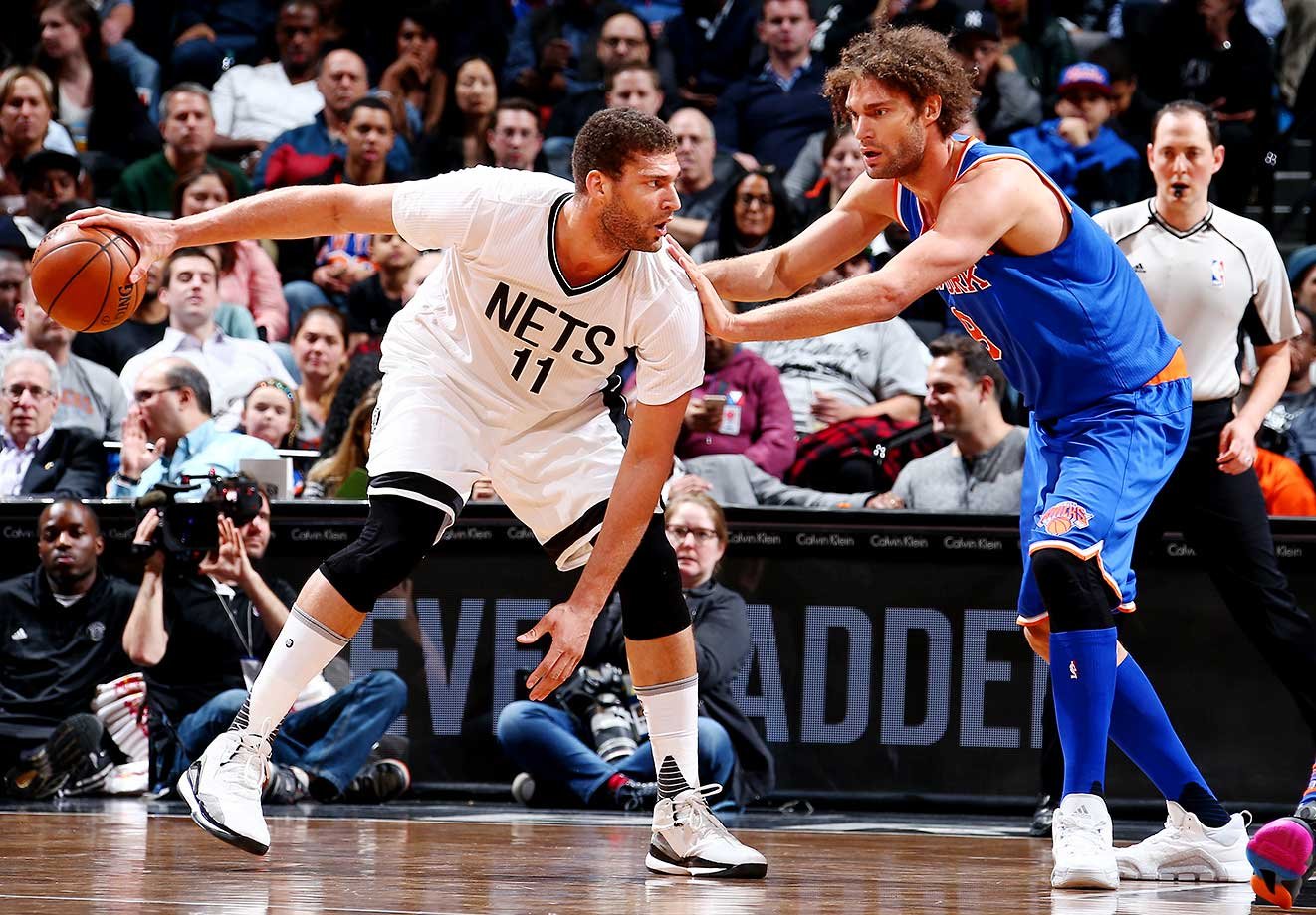Brook Lopez of the Brooklyn Nets handles the ball against his twin brother, Robin, of the New York Knicks.