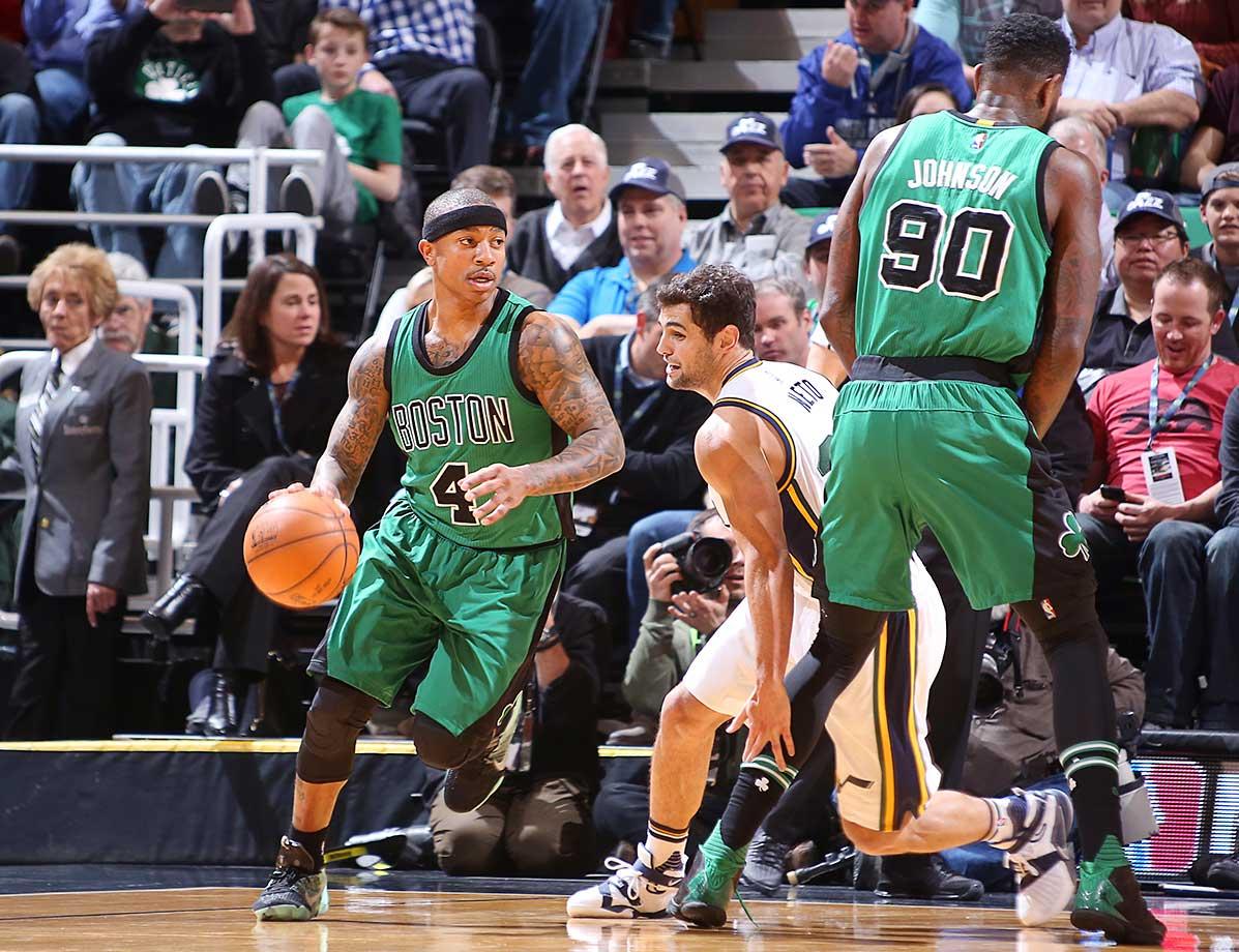 Isaiah Thomas of the Boston Celtics handles the ball against Raul Neto of the Utah Jazz.