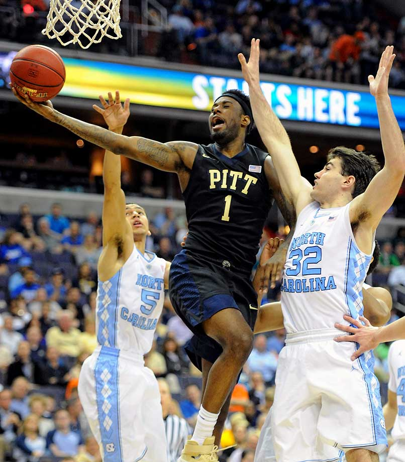 Pittsburgh forward Jamel Artis scores against North Carolina Tar Heels guard Marcus Paige (5) and forward Luke Maye (32).