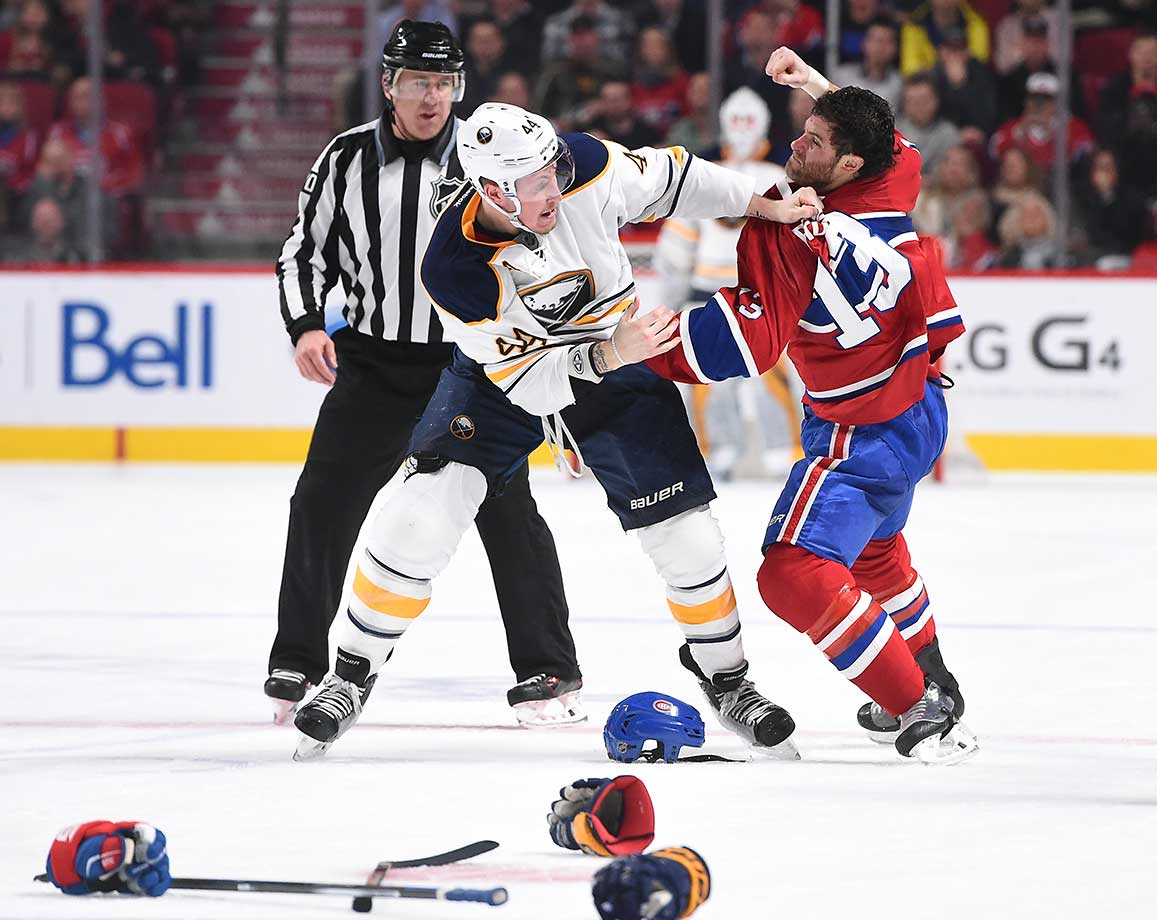 Mike Brown of Montreal and Nicolas Deslauriers of Buffalo fight during their game in Quebec.