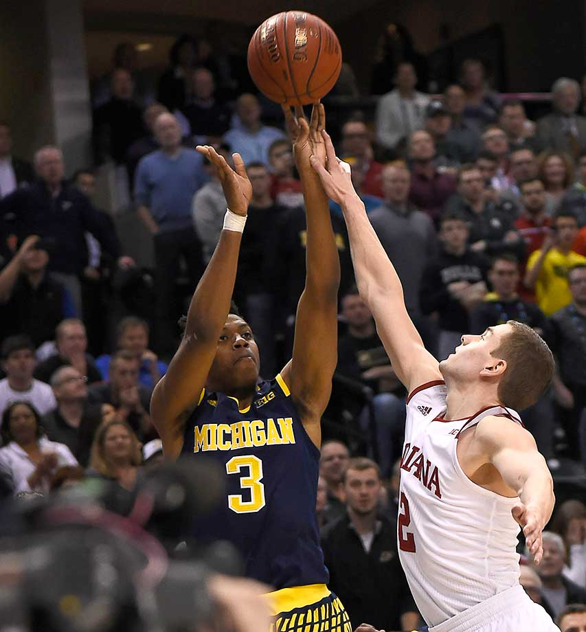 Here are some of the images that caught our eye on a buzzer-beating Friday in sports, starting with Michigan guard Kameron Chatman sinking the game-winning three-point basket to defeat Indiana.