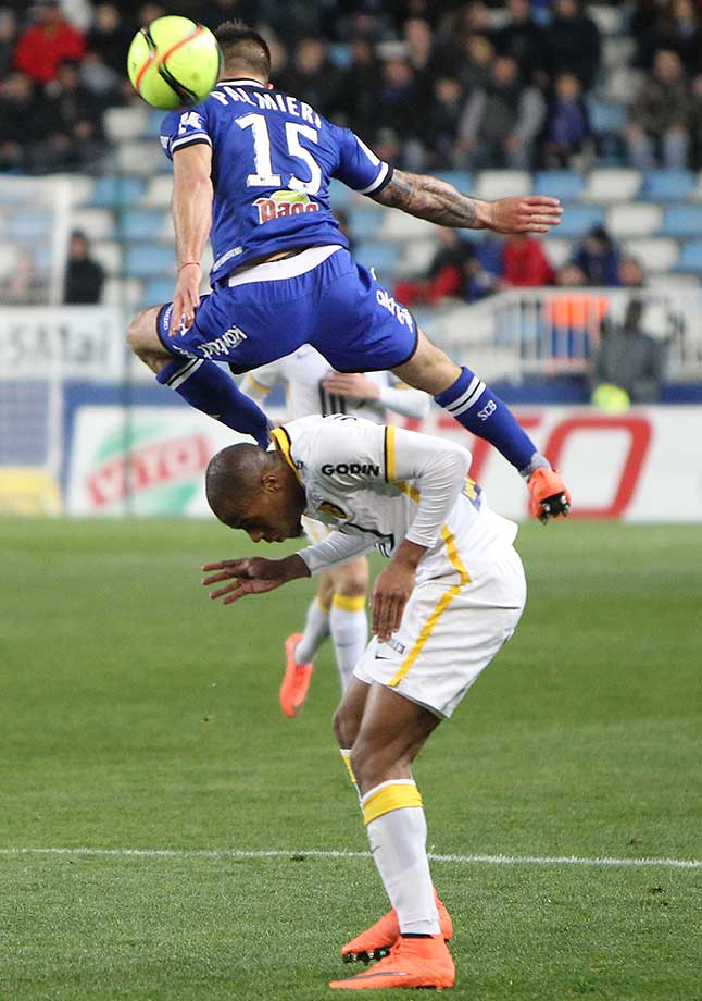 Bastia's Julian Palmieri (top) vies with LOSC Lille Djibril Sidibe during the French Ligue 1 football match.