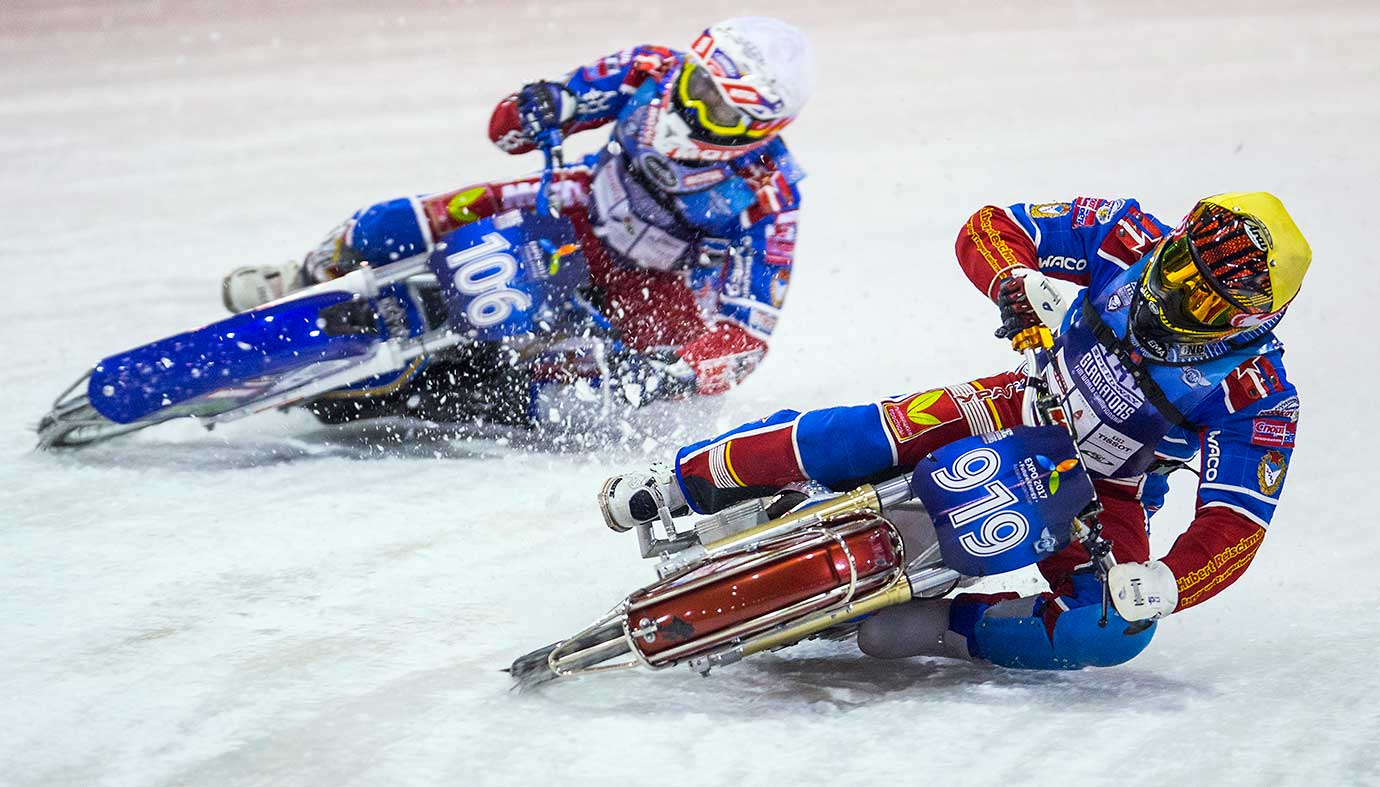 A pair of competitors in action during the Ice Speedway World Championship final in Assen, Netherlands. Riding on frozen surfaces and with studded tires, the motorcyclists can reach up to 60 mph on curves and in the 80s on straightaways.