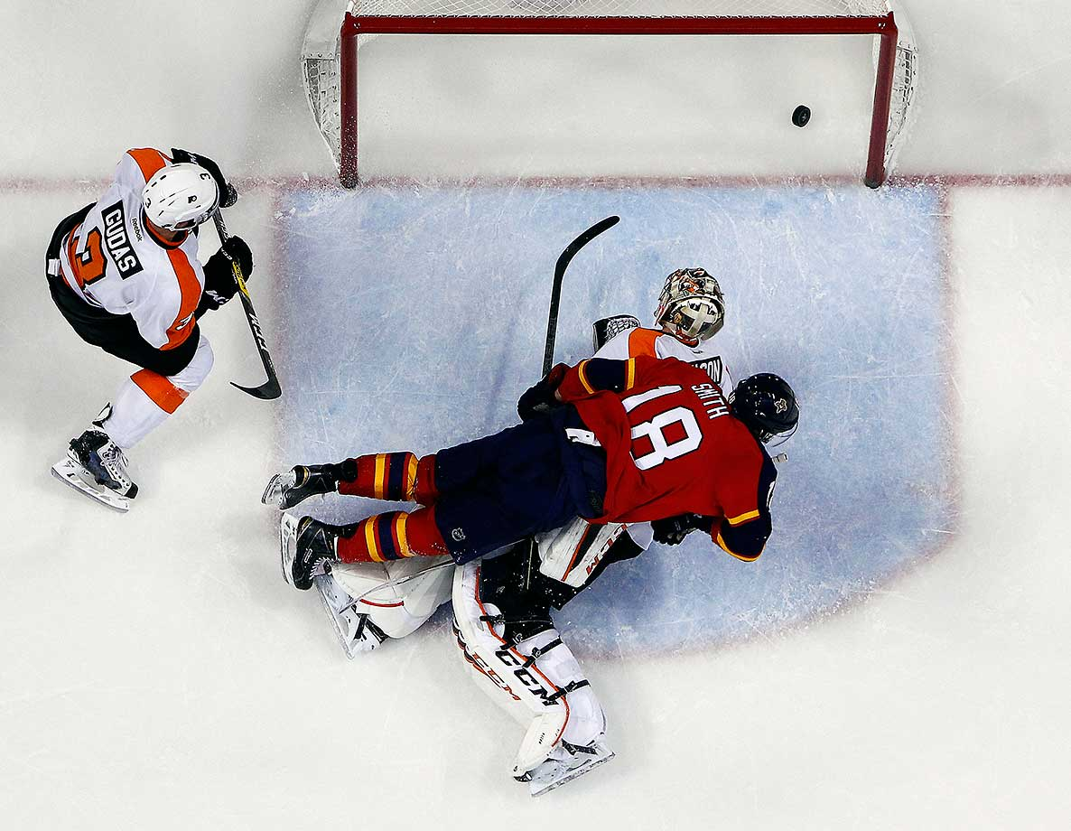 Reilly Smith of Florida lands on and scores against goaltender Steve Mason of the Philadelphia Flyers.