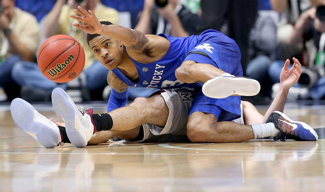 Tyler Ulis of the Kentucky Wildcats steals the ball in an 82-77 OT win over Texas A&M in the SEC final.