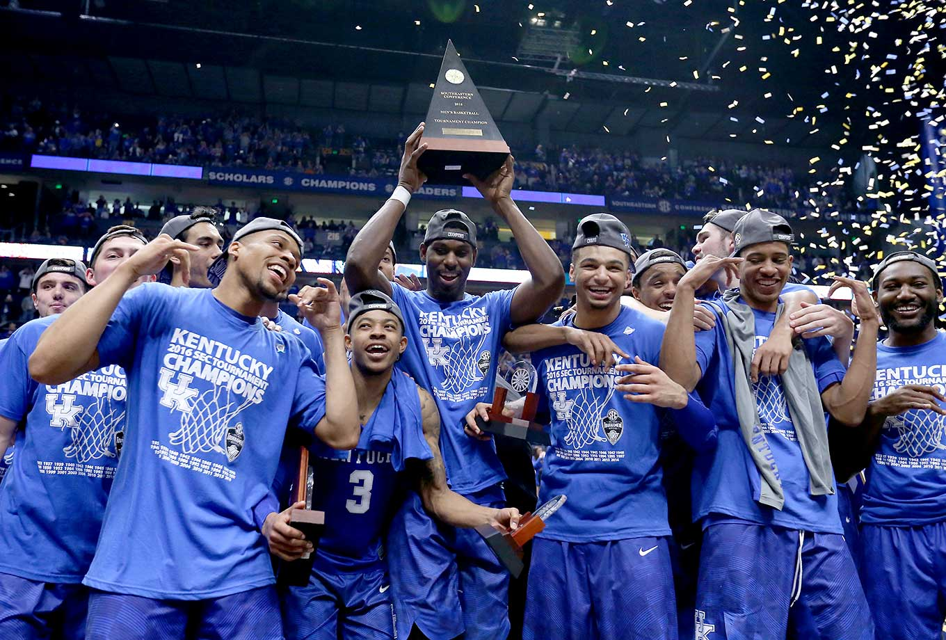 The Kentucky Wildcats celebrate after their 82-77 OT win over Texas A&M.