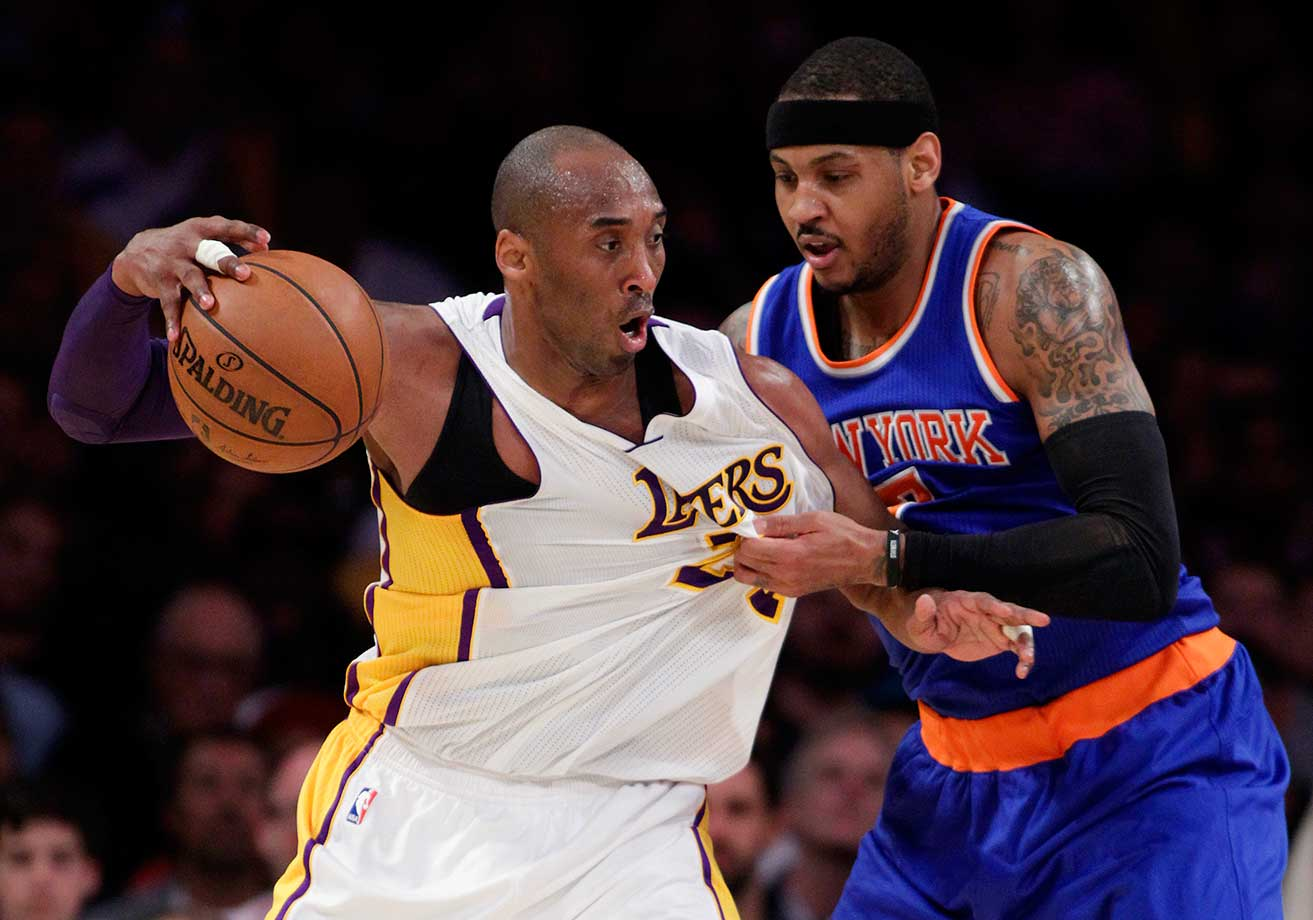 Carmelo Anthony tugs on the jersey as Kobe Bryant backs into him.