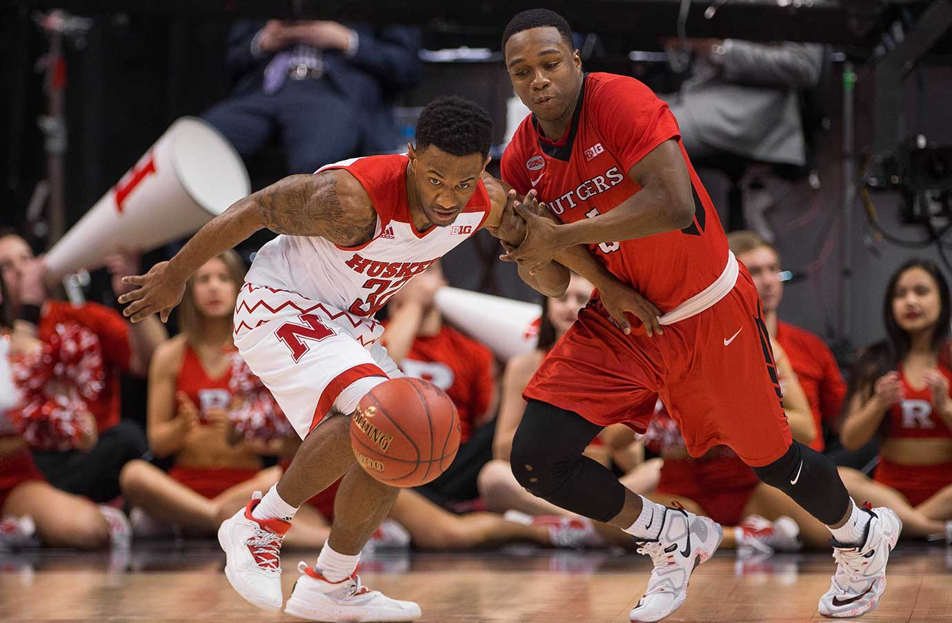 Rutgers guard Mike Williams grabs Nebraska Cornhuskers guard Benny Parker after a steal.