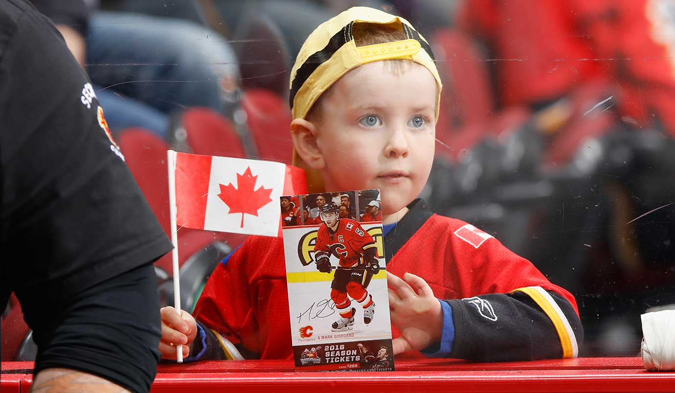 A young fan waits for warm up to begin between the Calgary Flames and the Nashville Predators.