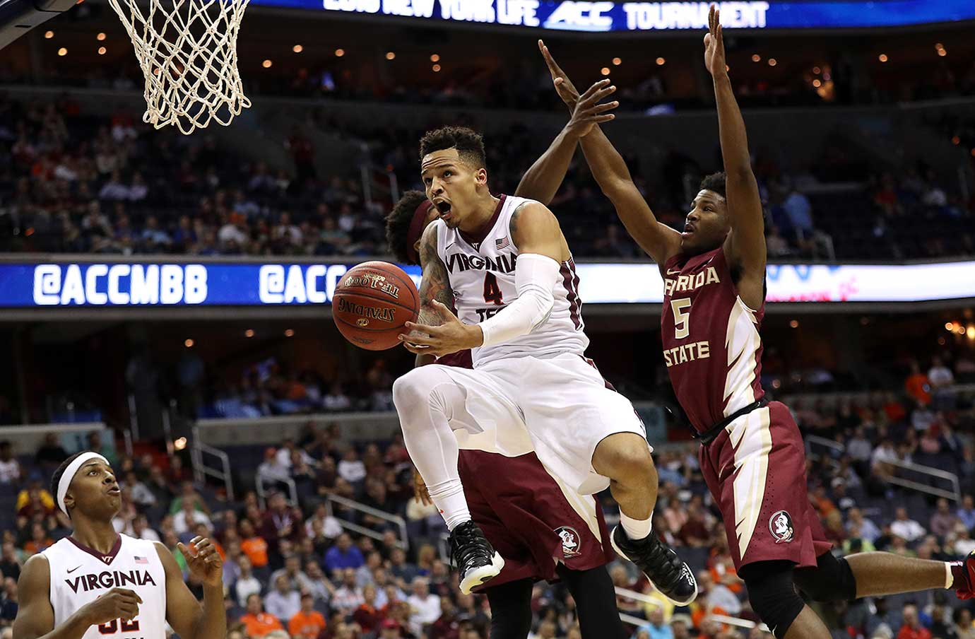 Seth Allen of the Virginia Tech Hokies shoots in front of Malik Beasley of Florida State.
