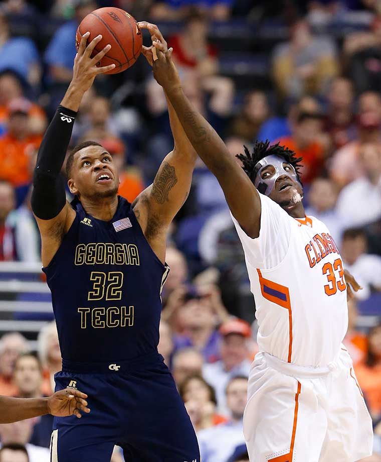 Masked man Josh Smith of Clemson vies for a rebound with Georgia Tech forward Nick Jacobs.