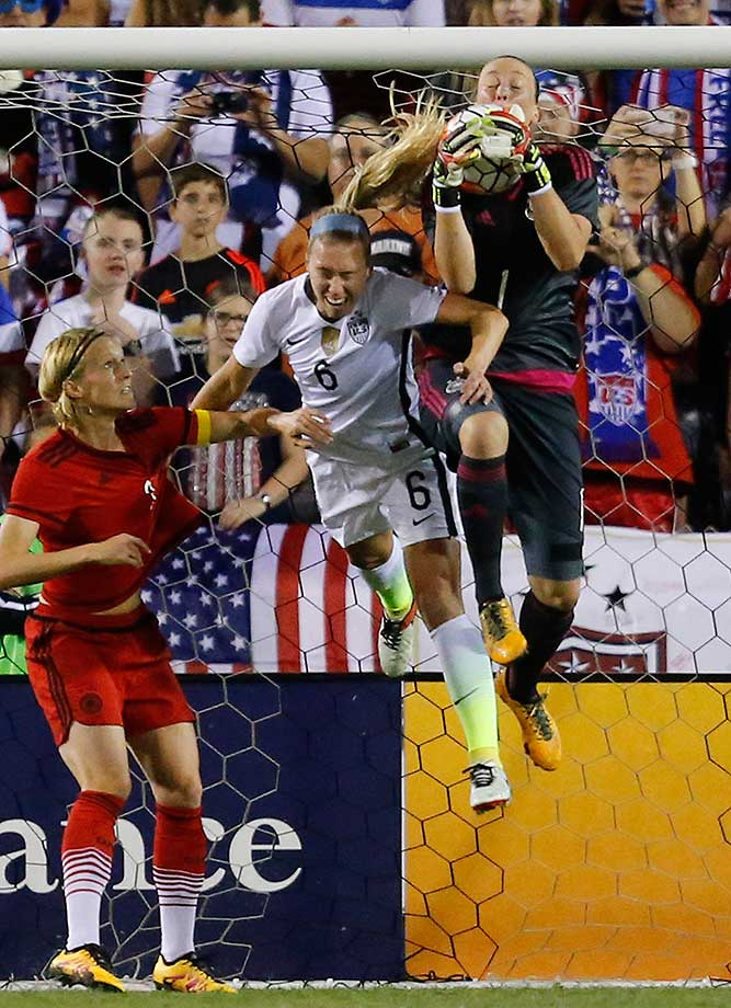 Germany's goalkeeper Almuth Schult catches the ball as Whitney Engen of the U.S. attempts to get to the rebound.