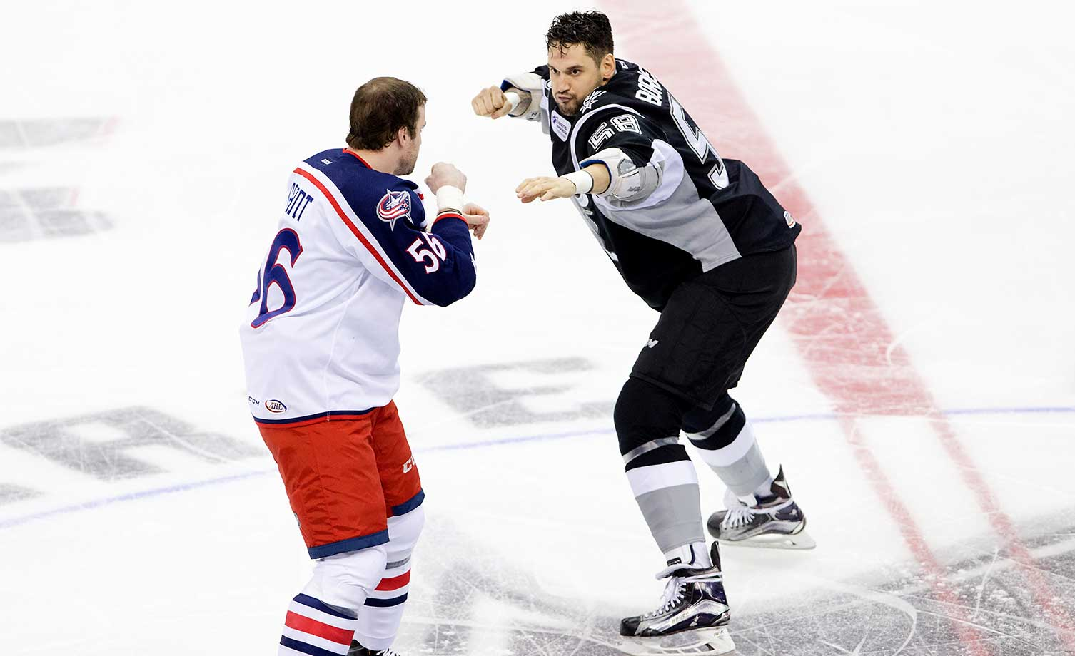 Patrick Bordeleau (58) of the San Antonio Rampage and Brett Gallant of the Lake Erie Monsters get ready to trade blows.