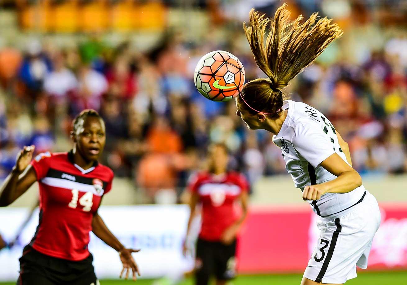 United States forward Alex Morgan hits a header during the Olympic qualifying soccer match against Trinidad & Tobago.