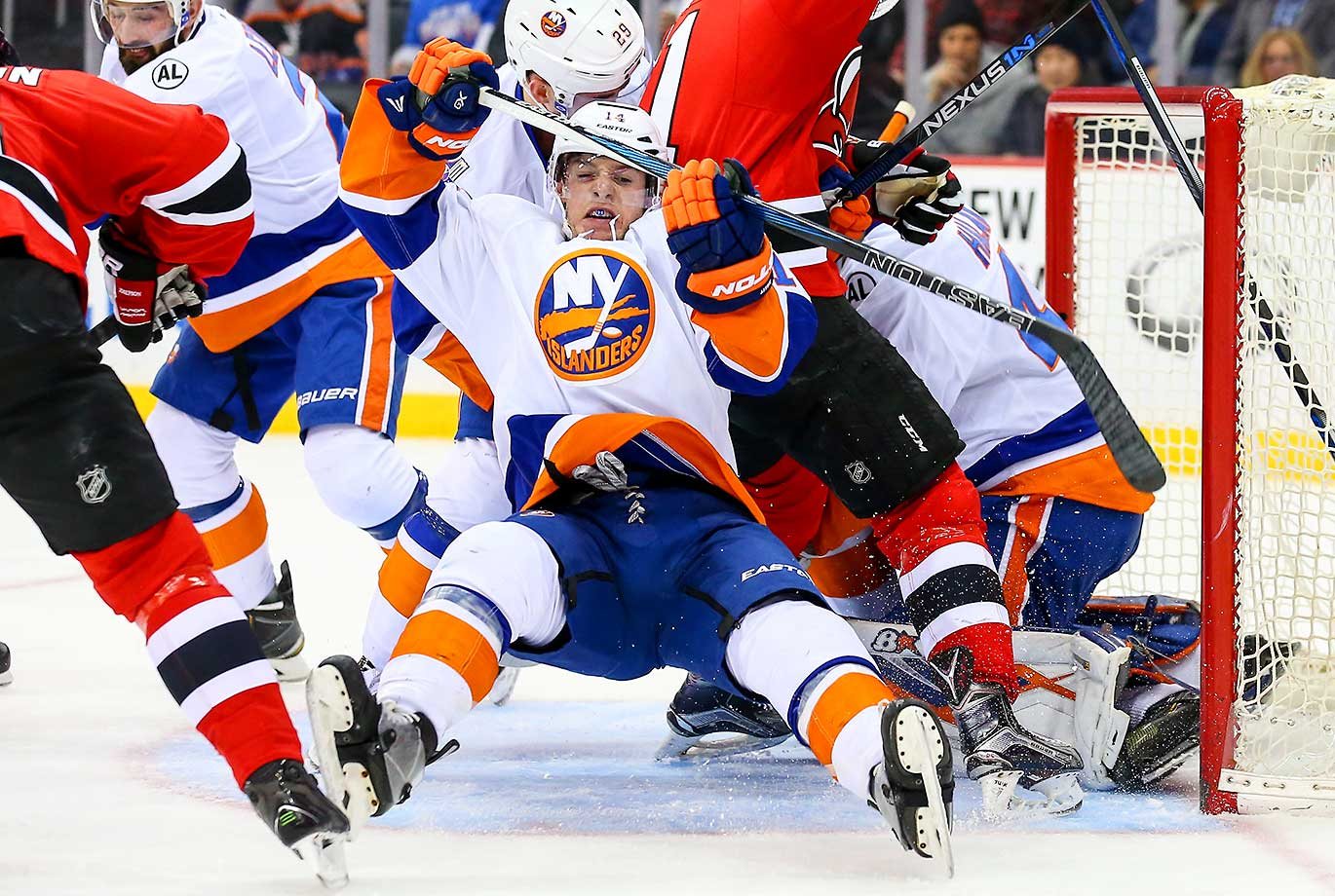 New York Islanders defenseman Thomas Hickey gets knocked down while facing the New Jersey Devils.