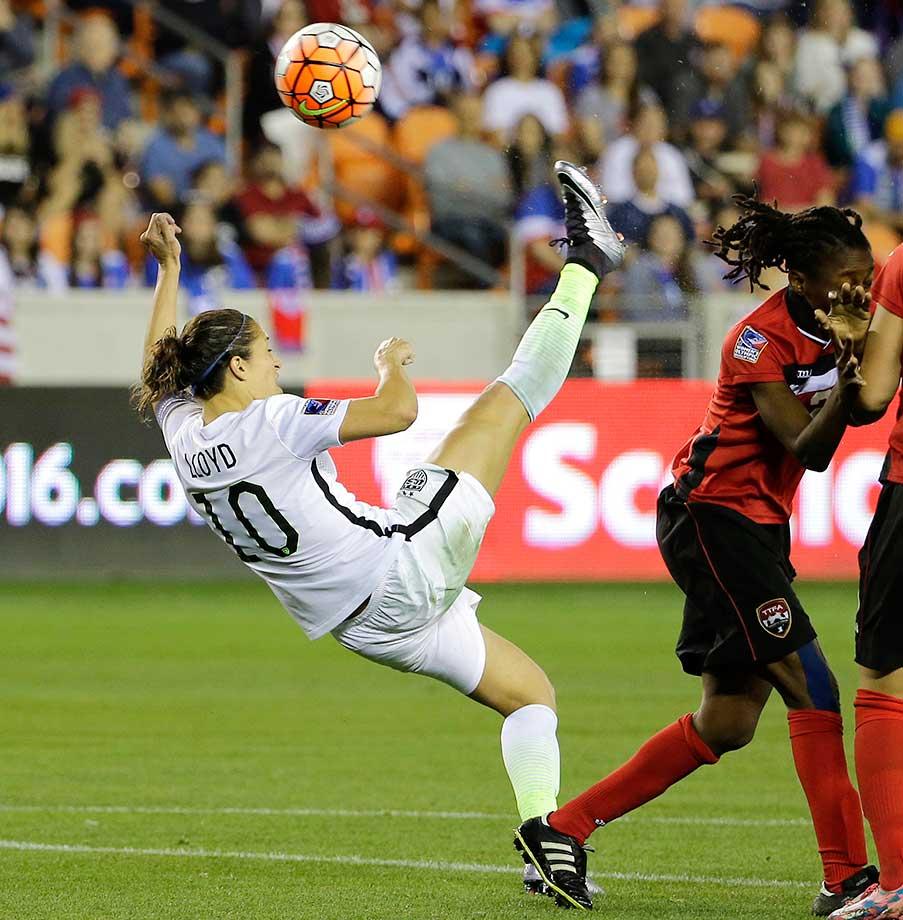 Carli Lloyd takes a shot on goal against Trinidad and Tobago.