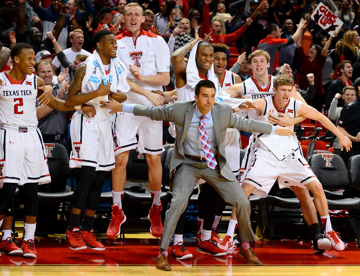 The Texas Tech Red Raiders bench celebrates after Devaugntah Williams hits the game-winning shot with .5 seconds left in overtime against Oklahoma State at United Supermarkets Arena in Lubbock, Texas. Texas Tech won the game in overtime 63-61.