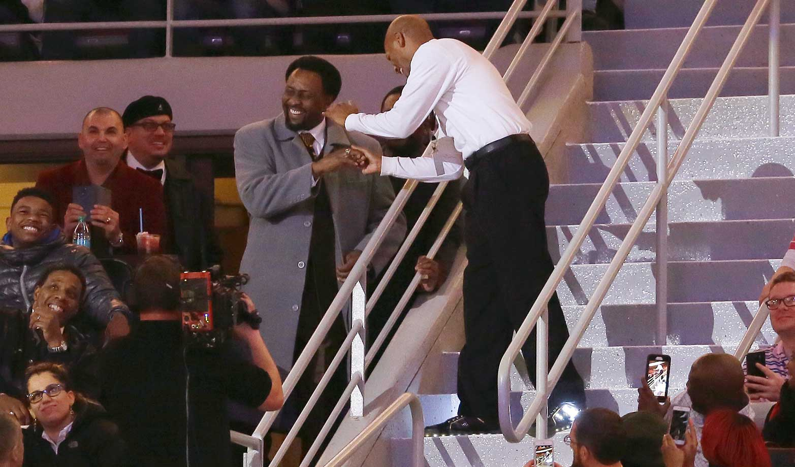 Detroit Pistons dancing usher Shannon Sailes, right, meets Thomas Hearns during a game between the Detroit Pistons and the Cleveland Cavaliers in Auburn Hills, Mich.