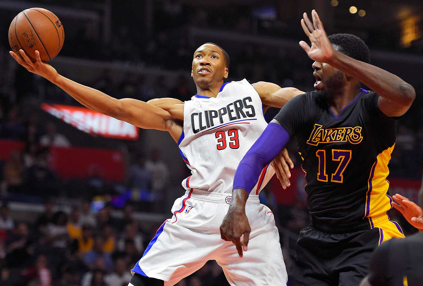 Los Angeles Clippers forward Wesley Johnson shoots as Los Angeles Lakers center Roy Hibbert defends in Los Angeles.