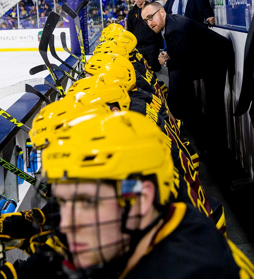 The Arizona State Sun Devils coaching staff stands behind the bench during a game against the Massachusetts Lowell River Hawks at the Tsongas Center. The River Hawks won 4-1.
