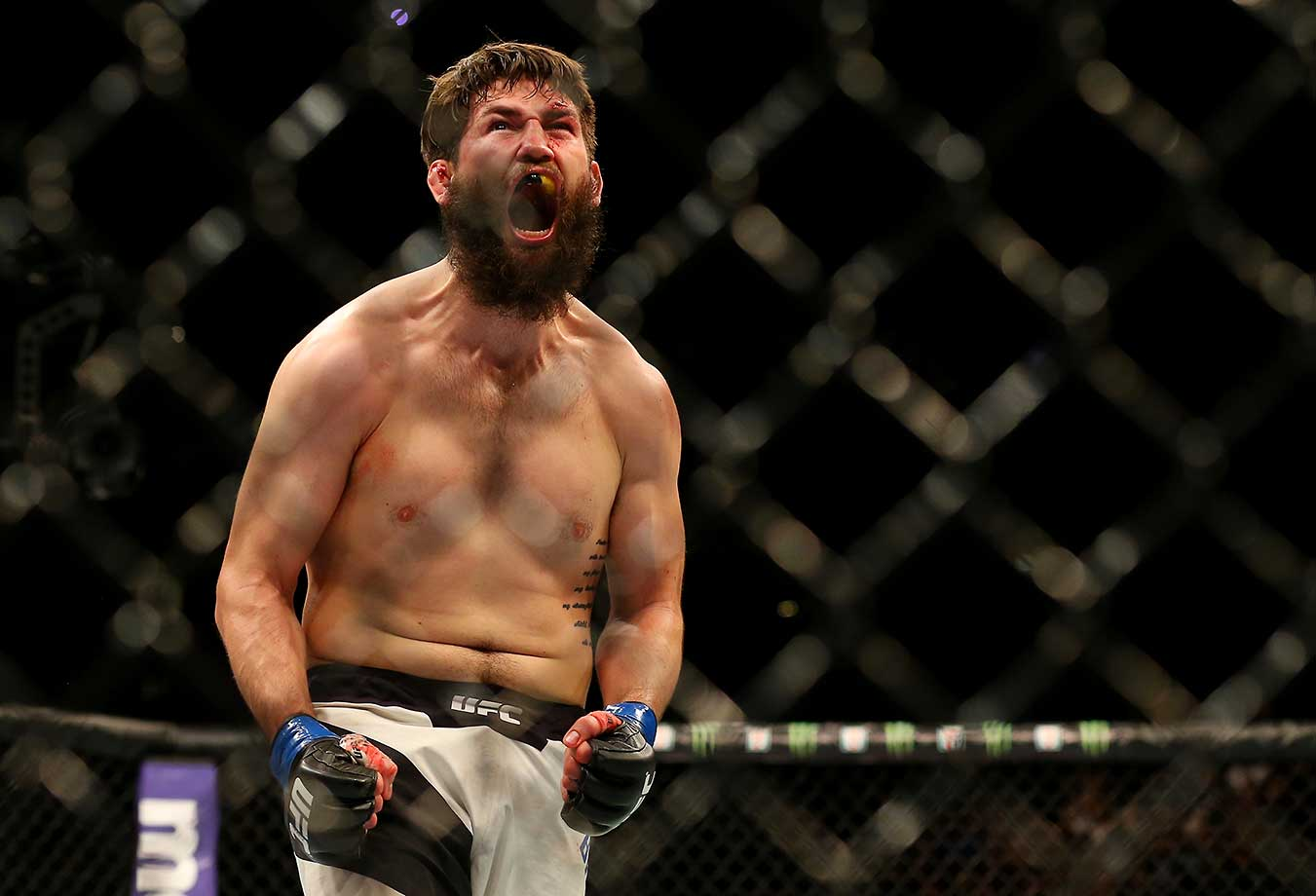 Bryan Barberena celebrates his submission victory over Sage Northcutt in their welterweight bout during the UFC Fight Night event at the Prudential Center in Newark, New Jersey.