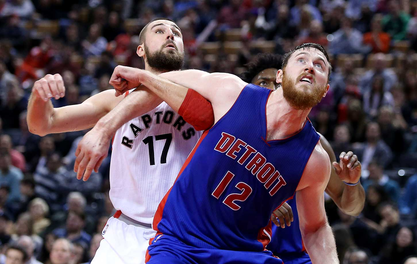 Jonas Valanciunas of the Toronto Raptors and Aron Baynes of the Detroit Pistons battle for a rebound in Toronto.