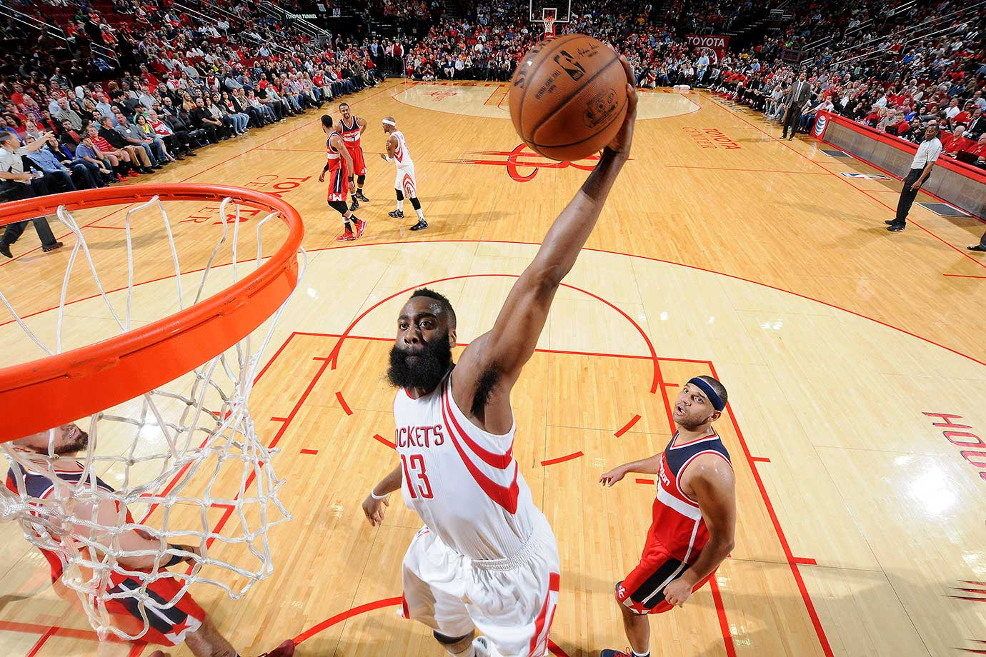 James Harden of the Houston Rockets goes for the dunk during the game against the Washington Wizards at the Toyota Center in Houston.