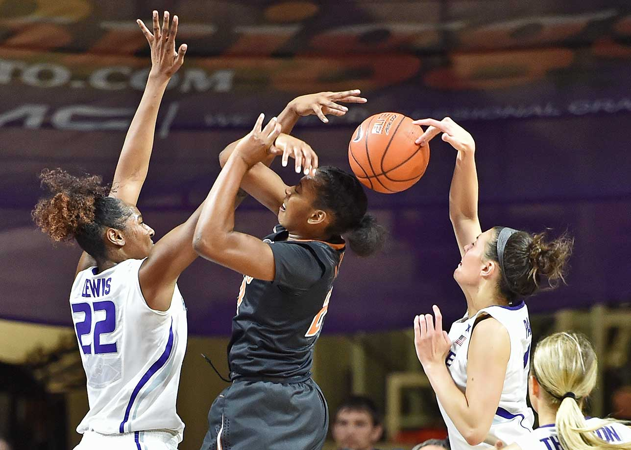 Kaylee Page of the Kansas State Wildcats blocks the shot of Ariel Atkins of the Texas Longhorns at Bramlage Coliseum in Manhattan, Kansas.  Texas defeated Kansas State 66-51.