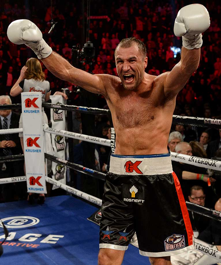 Sergey Kovalev of Russia celebrates his victory over Jean Pascal of Canada by way of TKO during the WBO, WBA, and IBF light heavyweight world championship match at the Bell Centre in Montreal.