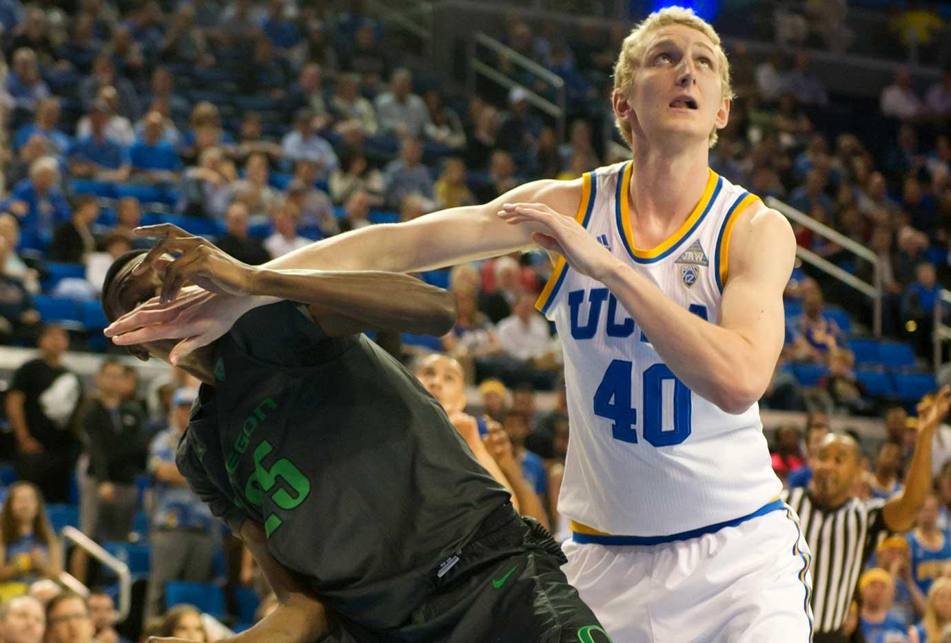 UCLA Bruins center Thomas Welsh fights for position against Oregon's Chris Boucher.