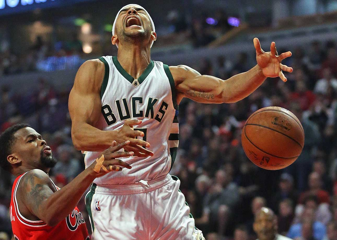 Jerryd Bayless of Milwaukee loses the ball after being fouled by Aaron Brooks of the Chicago Bulls.