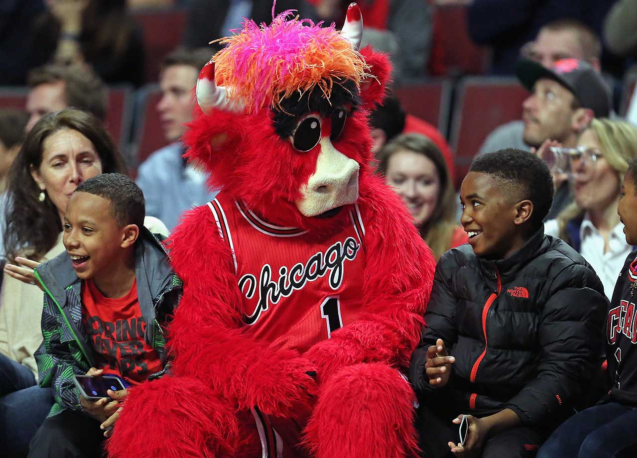 Benny, the mascot of the Chicago Bulls, entertains young fans siting courtside at the Bulls-Milwaukee Bucks game.
