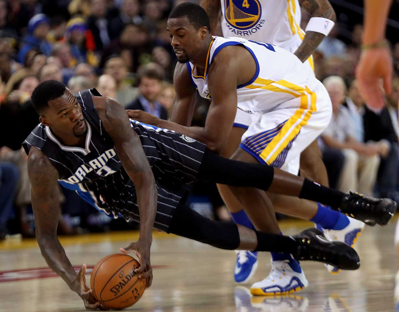 Dewayne Dedmon of Orlando and Harrison Barnes of Golden State go for a loose ball.