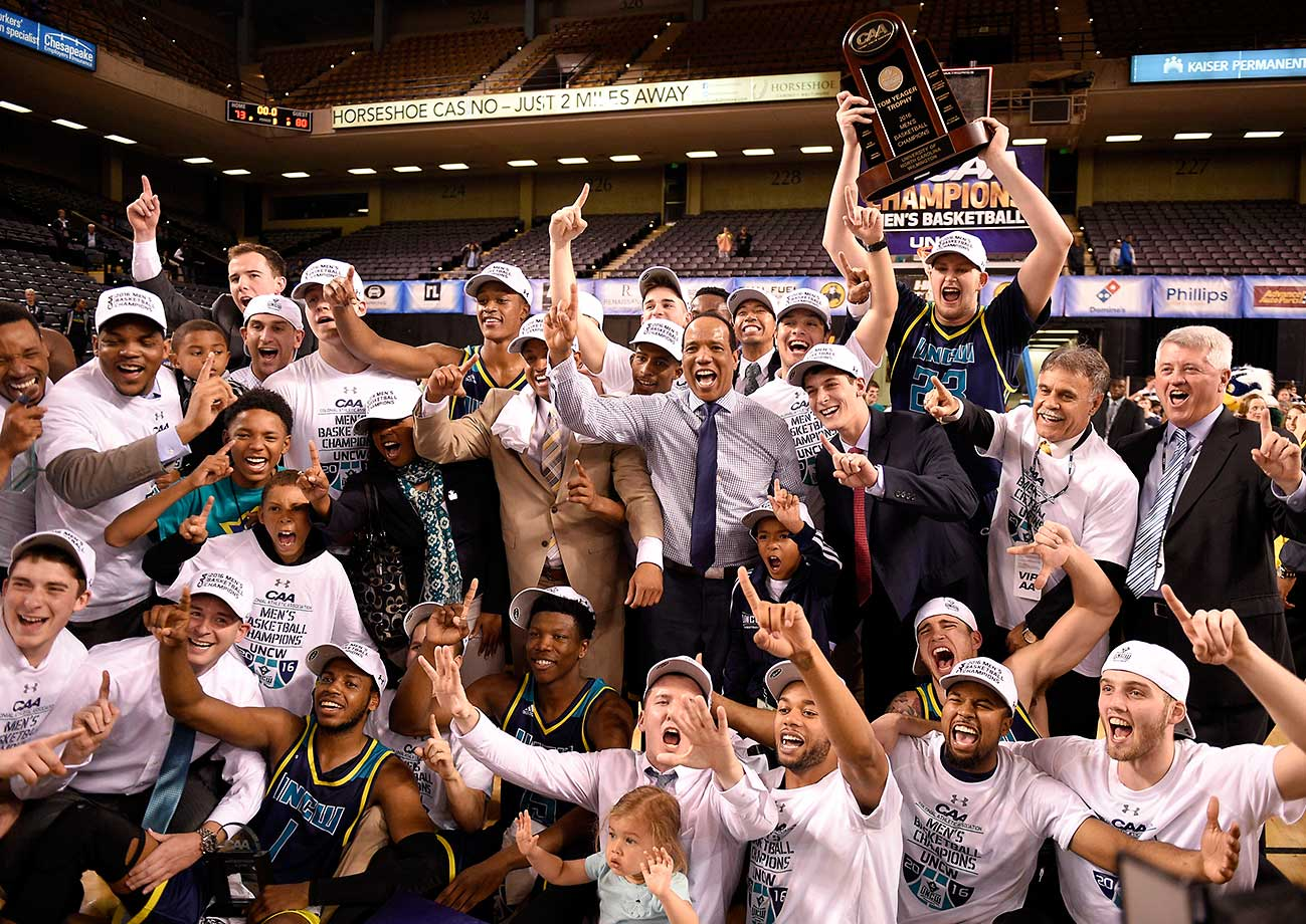 UNC Wilmington celebrates after it beat Hofstra 80-73 in overtime to win the Colonial Athletic Association championship.