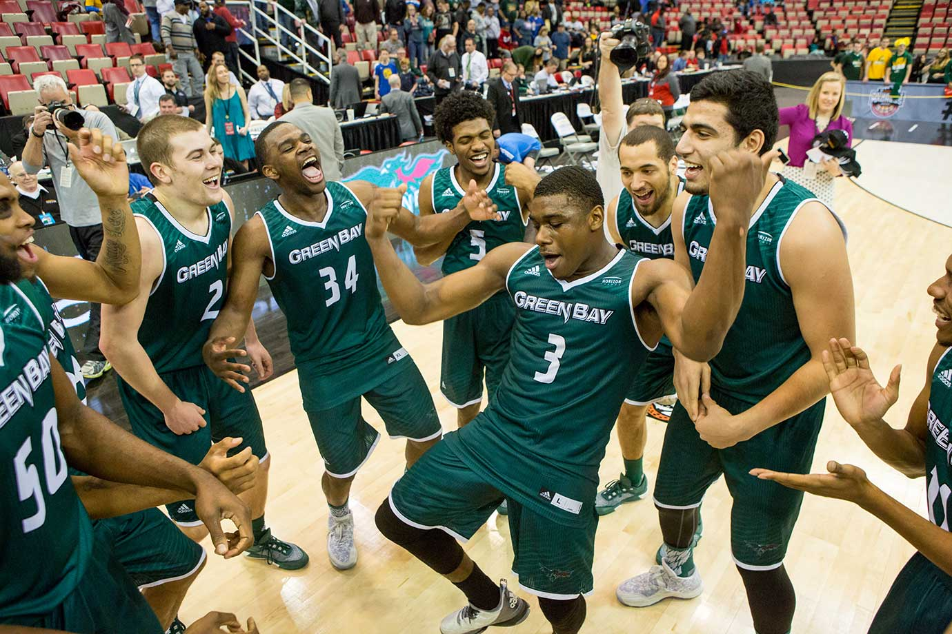 Here are some of the images that caught our eye on the sports night of March 8, starting with Green Bay guard Khalil Small leading his teammates in a cheer after winning the Horizon League tournament.