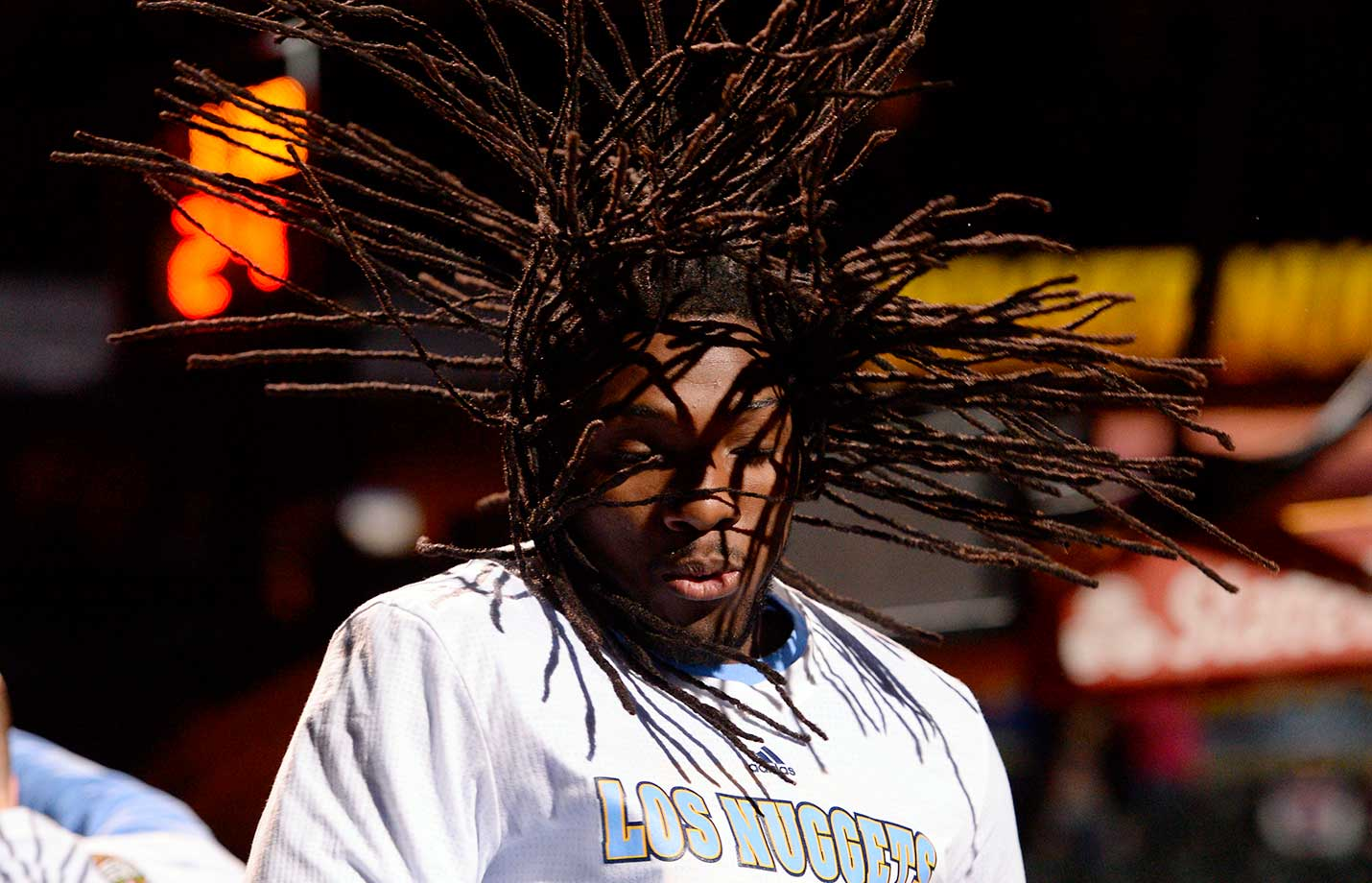 Denver forward Kenneth Faried lets his hair fly during player introductions agains the New York Knicks.